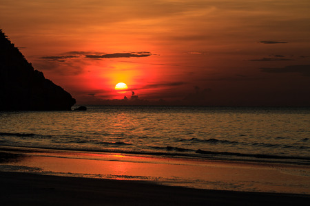beautiful sunrise on beach and tropical sea in summer