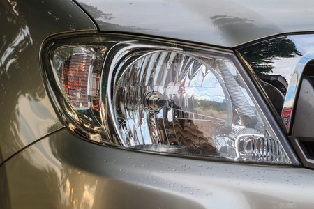 Close Up Headlights Of Car Background And Texture Photo