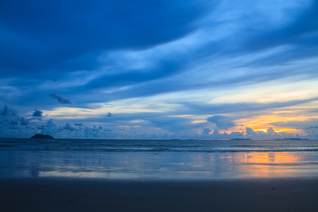 beautiful sunrise on beach and tropical sea in summer photo