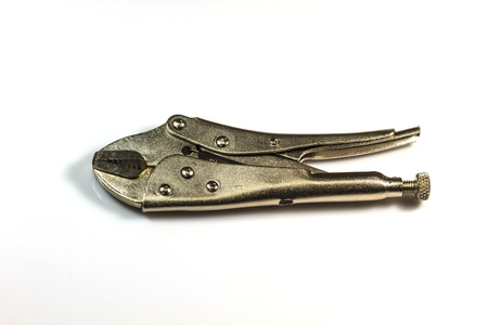 locking up: close up locking pliers isolated on a white background Stock Photo