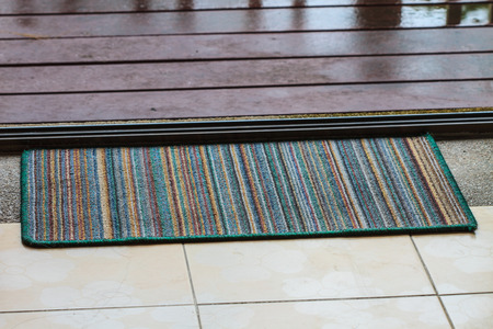 doormat with open door close up