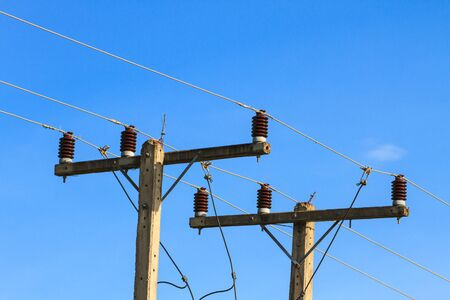 electricity pole: electricity pole on blue sky background in a village Stock Photo