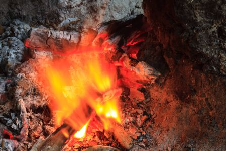 pyre: Close up of a bonfire with orange flames and firewood Stock Photo