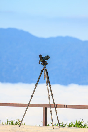 monocular: Birdwatching monocular or spotting scope on a tripod in forest