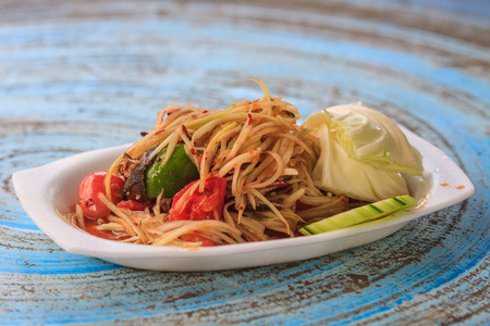 SOM-TAM, Thai delicious raw papaya salad with unique taste hot and spicy, this dish with tomato and crab.
