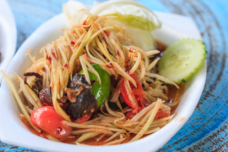 dishy: SOM-TAM, Thai delicious raw papaya salad with unique taste hot and spicy, this dish with tomato and crab.