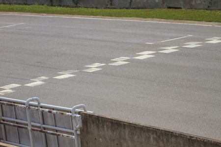 indy cars: Start and Finish motor race line asphalt in the circuit