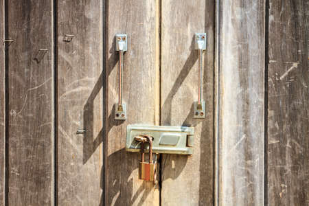 pad lock: Padlock on wooden background, pad lock secures an old door