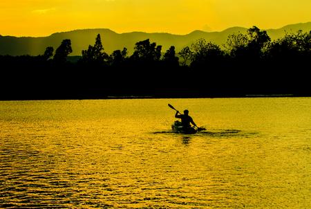 kayaker: Abstract nature, Kayaks and sunste, in Lake Dam Kaeng Krachan, Thailand Stock Photo