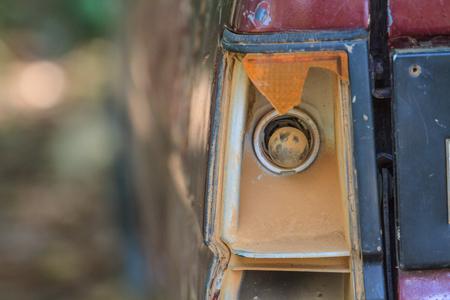 totaled: Detail of a broken brake light, trashed crashed accident car Stock Photo