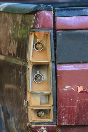 trashed: Detail of a broken brake light, trashed crashed accident car Stock Photo