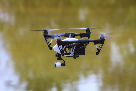 flying drone with camera on the sky Standard-Bild