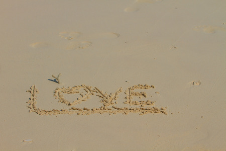 sand drawing: Word LOVE on sand, Drawing love word on beach
