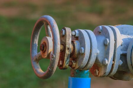 pipework: Water valve and steel pipe in garden Stock Photo