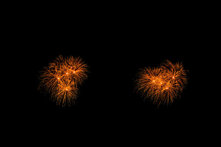 abstract Fireworks light up the dark sky background