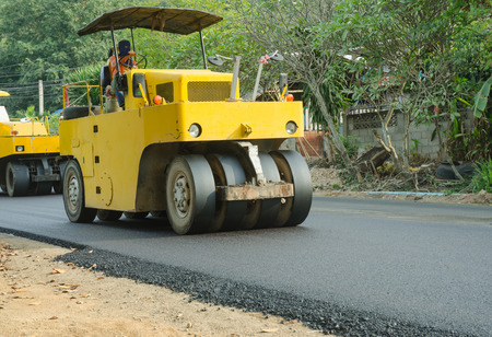 Road roller machine works on the fresh asphalt, Asphalt road construction Stock Photo