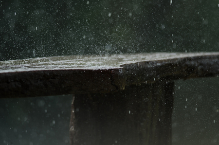 The rain fell on a wooden chair, abstract nature background