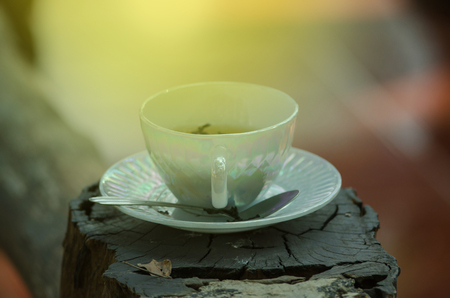 cup of hot herbal tea on the old wooden background Standard-Bild