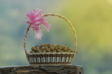 Fresh longan fruits in Gift Baskets on wooden