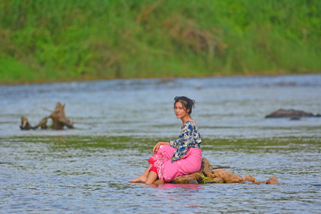 Portrait of young girl in river, Young girl posing on the water