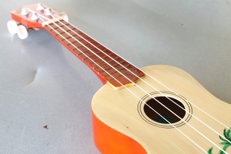 acoustic ukulele: Acoustic Guitar Ukulele with metal background