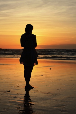 happieness: silhouette of a woman  on a beach at sunset