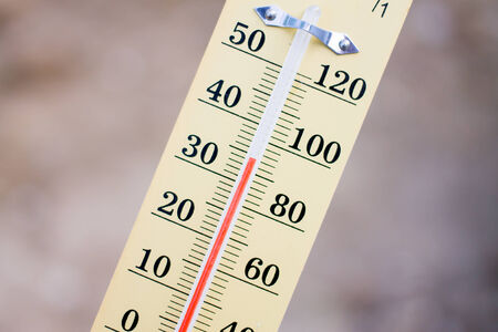 Wooden Thermometer on brown background