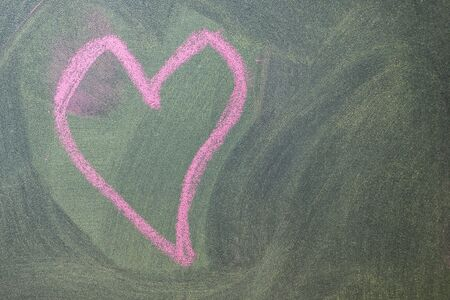 Hand drawn pink hearts on chalkboard background. photo