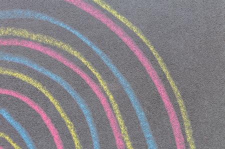 Colorful chalk with spin cycle on chalkboard background
