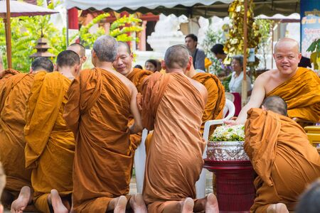 pour water: CHIANG MAI ,THAILAND - APRIL 15 : The traditional Songkran festival at pour water onto Buddha image and monks. It is the gesture of worship in Songkran festival at Watphadarabhirom a famous temple on April 15, 2015 in Chiangmai,Thailand.