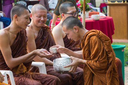 pour water: CHIANG MAI ,THAILAND - APRIL 15 : The traditional Songkran festival at pour water onto Buddha image and monks. at Watphadarabhirom a famous temple on April 15, 2015 in Chiangmai,Thailand. Editorial