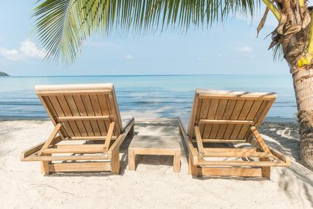 wooden chair on the klong jao beach at Koh Kood(kood island) , Thailand