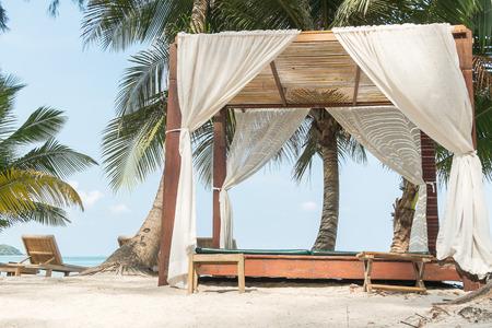 wooden chair on the klong jao beach at Koh Kood(kood island) , Thailand photo