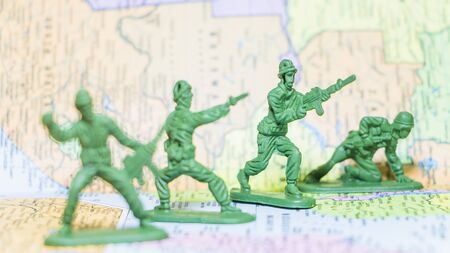 display figure: Toy Soldiers is an action and strategy on paper map background Stock Photo