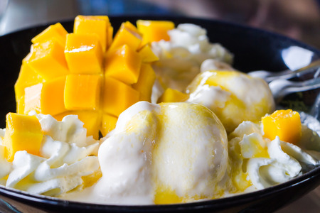 Vanilla Ice Cream With Fresh Mangoes on Black plate