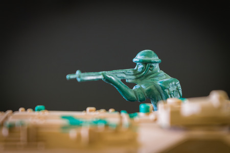 toy soldier: Closeup of action mini toy soldier on black background