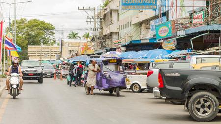 auto rickshaw: Ayutthaya Thailand - August 22: Auto rickshaw three-weeler tuk-tuk taxi driver   For services to tourists  around Ayutthaya city on Auguust 22 ,2015 ,Ayutthaya Thailand