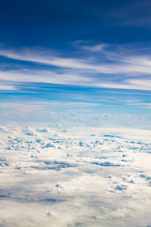 sky: White fluffy clouds in the blue sky
