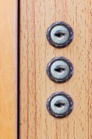 key hole: Key hole on wooden background