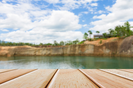 Empty Wooden deck table over blur nature background Stock Photo