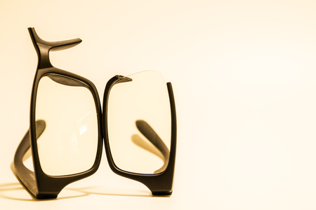 shortsightedness: Closeup of Broken plastic Eyeglasses on colored background Stock Photo