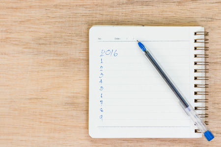 Goals for 2016 - checklist on notepad with pen on wooden background