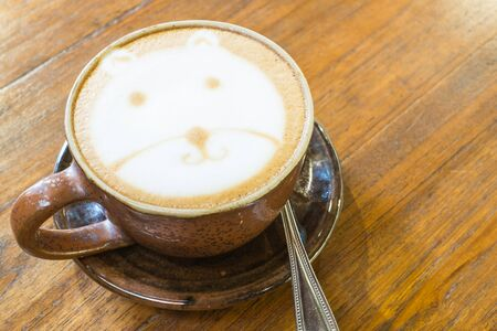 mocca: Hot Cappuccino on wooden background ,Cup of art coffee