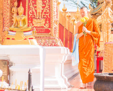 homage: Chiang mai - Thailand - Feb 2 2016 : Monk pay homage around Wat Phra That Doi Suthep. on February 2 ,2016 at Chiang Mai - Thailand