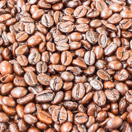 non alcoholic beverage: Brown roasted coffee beans , texture background