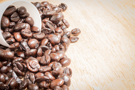 non alcoholic: Brown roasted coffee beans on  wooden background Stock Photo