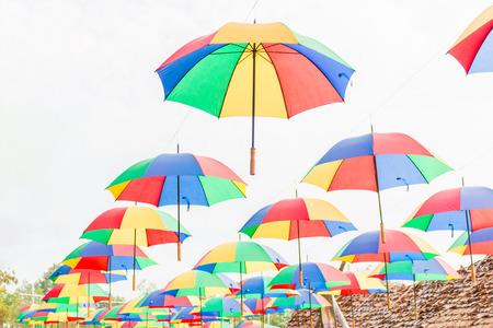 rainbow umbrella: Rainbow umbrella on sky background