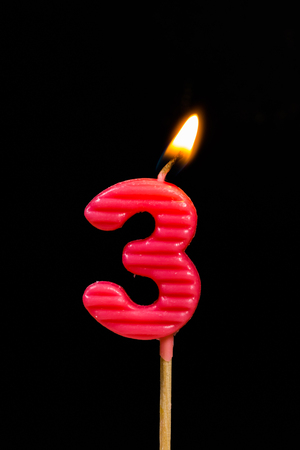number 3: Birthday-anniversary candles showing Number. 3 Stock Photo