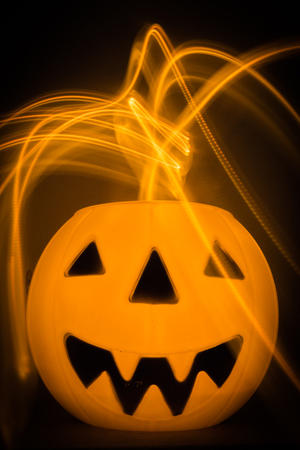 Scary Halloween background with pumpkins on black Stock Photo