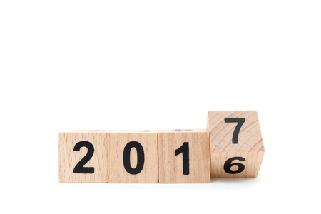 New year concept , Word 2016 on wood block and moving to the word 2017 Stock Photo